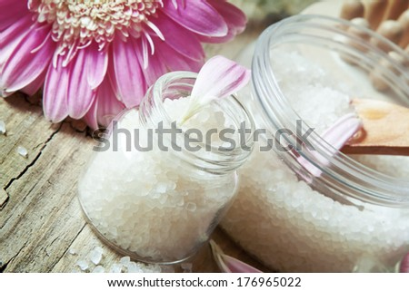 Healthy Sea Salt in Bottles and Pink Flower.Aromatherapy settlement - stock photo