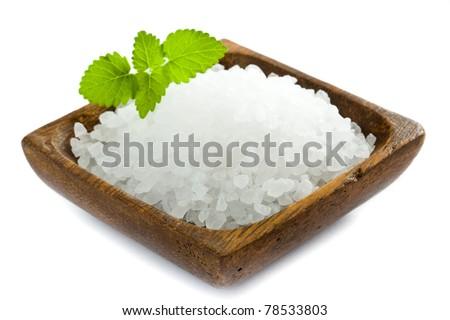 Healthy sea salt in wooden bowl closeup - stock photo
