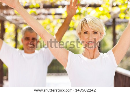 healthy senior couple working out outdoors - stock photo
