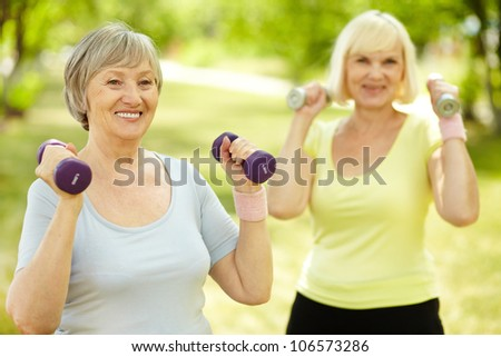 Healthy senior ladies keeping fit outdoors - stock photo