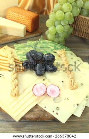 healthy Slices of cheese with grapes and radisches - stock photo