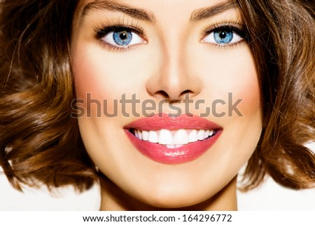 Healthy Smile. Teeth Whitening. Beautiful Smiling Young Woman Portrait close up. Over White background . Laughing Girl with Perfect Shin - stock photo