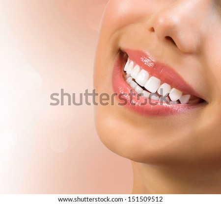 Healthy Smile. Teeth Whitening. Dental care Concept. Woman Smile Closeup. Beautiful Lips and Teeth - stock photo