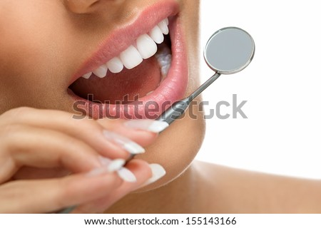 Healthy smiling with great teeth and a dentist mirror - stock photo