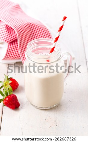 Healthy  smoothie or milk  in a jar against old wooden table