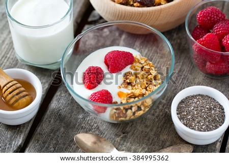 healthy snack - granola on wooden surface - stock photo