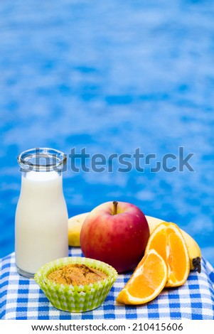 Healthy snack with homemade poppy seed muffin, fruit and fresh milk - stock photo