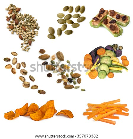 Healthy snacking collection isolated on white.  Includes seeds, nuts, trail mix, sweet potato fries, vegetable crisps and carrot sticks. - stock photo