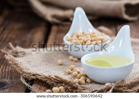 Healthy Soy Oil on dark rustic wooden background - stock photo