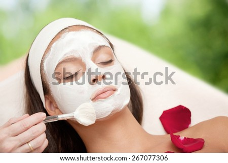 Healthy Spa: Young Natural Relaxing Beauty Having Moistening Mask Applied - stock photo
