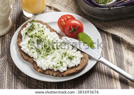 healthy spring summer low fat breakfast with orange juice,coffee,bread,cottage cheese, cress and tomatoes - stock photo