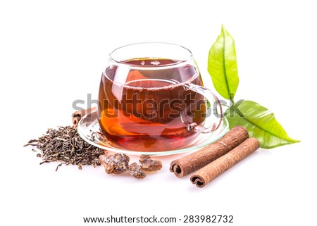 Healthy tea in glass cup on white background - stock photo