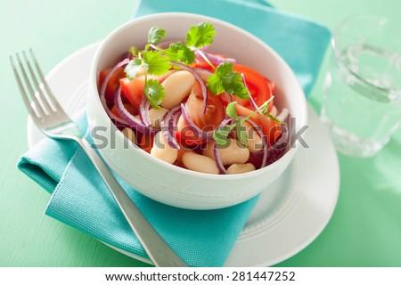 healthy tomato salad with white beans onion coriander - stock photo