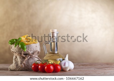 Healthy traditional food concept with pasta and other  ingredients on old wooden table - copyspace - stock photo
