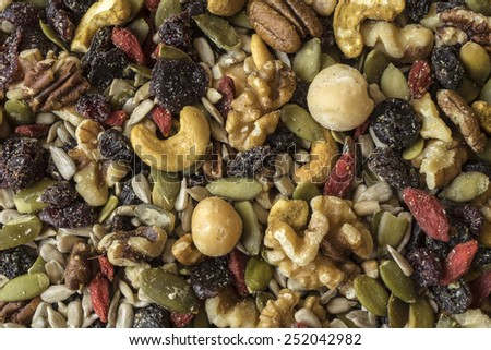 Healthy trail mix of nuts, seeds, and dried fruits - stock photo