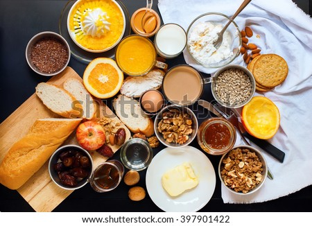 Healthy Various Assortment Set Breakfast Toast Egg Nut Butter Milk Orange Juice Black Table Top View - stock photo