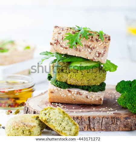 Healthy vegan burger with broccoli and spinach patty Healthy fast food on a cutting wooden board.Copy space