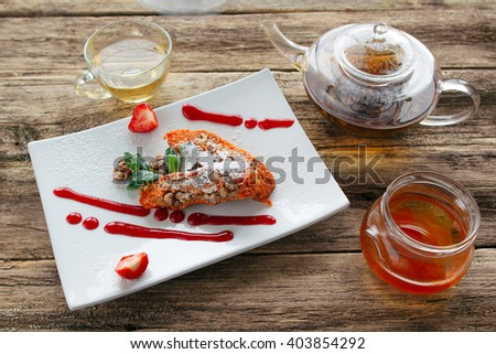 Healthy vegetable dessert. Carrot apple  sweet pie with a mango jam and a pot of herbal tea served on wooden background. Healthy vegetable dessert for vegetarian or lent.  - stock photo