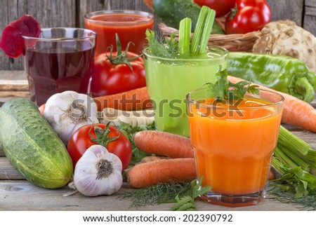 Healthy vegetable juices of carrot, celery, beetroot and tomato - stock photo