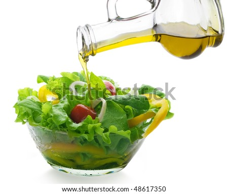 Healthy Vegetable Salad and pouring oil - stock photo