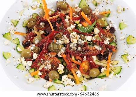 Healthy vegetable salad on white plate