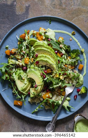 Healthy vegetarian salad with quinoa, butternut squash and avocado