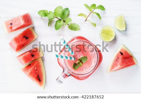 Healthy watermelon drink and fresh watermelon on white background - stock photo