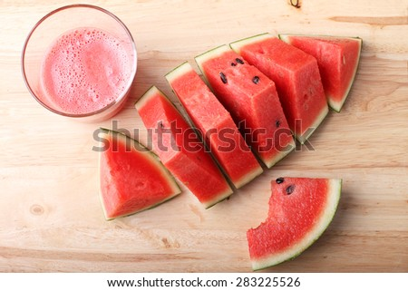 Healthy watermelon smoothie and fresh watermelon on a wooden background - stock photo