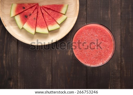 Healthy watermelon smoothie on a wood background - stock photo