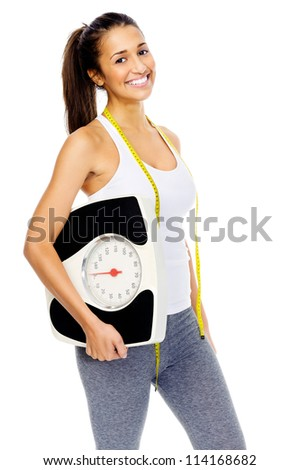 Healthy weightloss woman holding scale and smiling towards camera isolated on white background. - stock photo