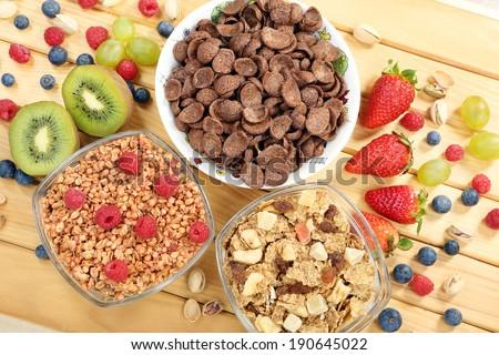 Healthy whole grain muesli and bran breakfast with fruits - stock photo