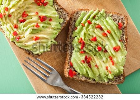 healthy wholegrain bread with avocado lime chili - stock photo
