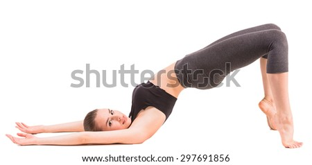 Healthy woman doing yoga exercise at studio.