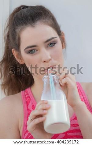 healthy woman drinking dairy milk - stock photo