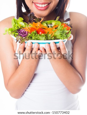 Healthy woman eating vegetable salad on  white background - stock photo