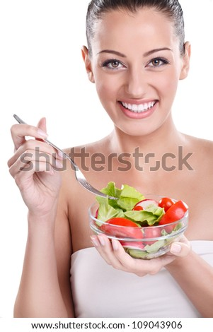 Healthy woman eating vegetables salad - stock photo