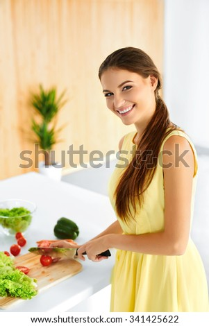 Healthy Woman. Happy Smiling Girl Preparing Vegetarian Dinner, Cutting Vegetables, Cooking Salad With Knife In Kitchen. Healthy Food, Lifestyle And Eating. Diet, Dieting Concept. Nutrition.