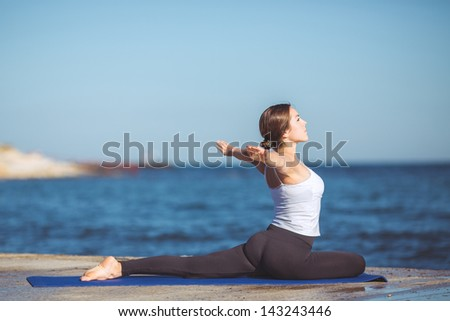 Healthy woman resting and curl up in fetal position outdoor at the sea: yoga pose. Series.