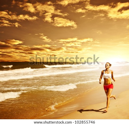 Healthy woman running on the beach, girl doing sport outdoor, happy female exercising, freedom, vacation, fitness and heath care concept with copy space over natural warm sunset background - stock photo