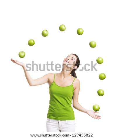 Healthy woman throwing apples, isolated over a white background - stock photo
