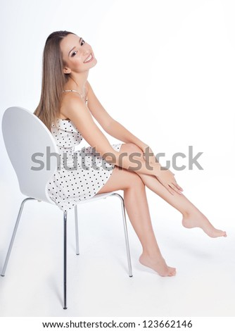 healthy woman with attractive perfect legs over white background - stock photo