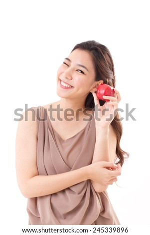 healthy woman with red apple, brown dress for summer and spring season - stock photo