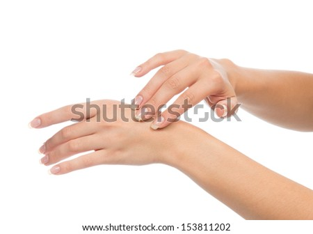 Healthy young female ands with french manicure nails isolated on a white background. Nail and skin care concept