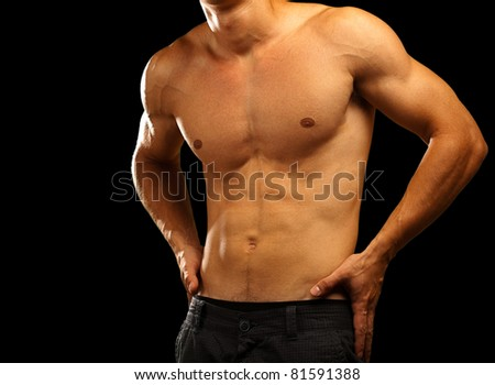 healthy young man on a black background - stock photo