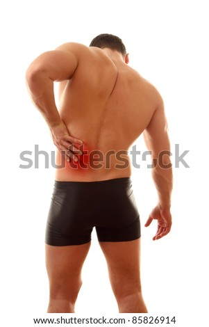 Healthy young man with pain in his back isolated - stock photo