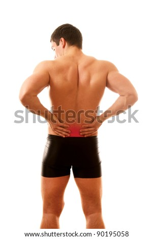 Healthy young man with pain in his back isolated on white background