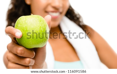 Healthy young mixed race woman holding green apple isolated on white background - stock photo