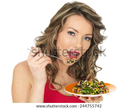 Healthy Young Woman Eating an Aromatic Rainbow Asian Style Salad