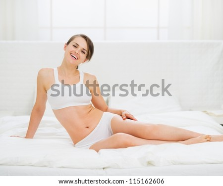 Healthy young woman laying in bed