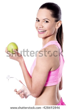 Healthy young woman with apple and water bottle. - stock photo